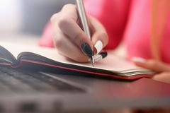Woman study hard write down information to notebook royalty free stock image