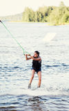 Woman study riding wakeboard Stock Photography