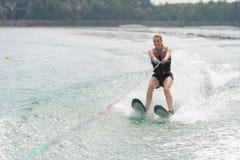 Woman study waterskiing on lake Stock Photography