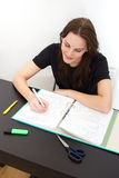 Woman Studying. Young Woman Writing Something For The University Royalty Free Stock Photography