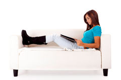 Woman studying. Young happy woman studying on a couch Stock Photo