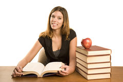 Woman studying. A young woman studying a large text book Royalty Free Stock Photos