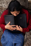 Woman Studying the Bible and Praying Stock Images