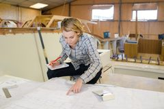 Woman studying blueprint boat Stock Images