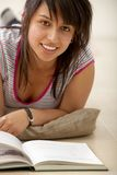 Woman studying with a book Royalty Free Stock Photography