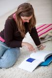 Woman studying with books Stock Photography