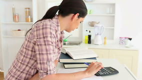Woman studying with calculator Royalty Free Stock Photography