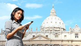 Woman studying a city map at Vatican stock video footage