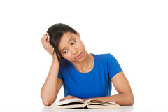 Woman studying at the desk being tired Royalty Free Stock Images