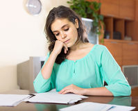 Woman studying documents Stock Photos