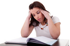 Woman studying with headache Royalty Free Stock Images