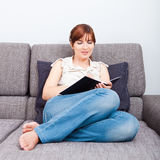 Woman studying at home Royalty Free Stock Photo