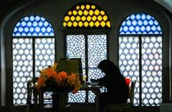 Woman studying Koran. Muslim woman studying Koran in the library in Kashan, Iran Royalty Free Stock Images