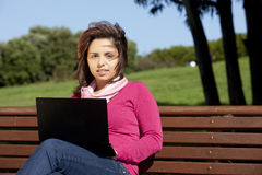 Woman studying with a laptop Stock Photos