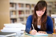 Woman studying at the library Stock Image