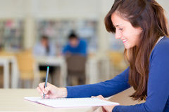 Woman studying at the library Royalty Free Stock Photos