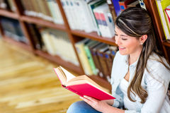 Woman studying at the library Royalty Free Stock Images