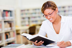 Woman studying at the library Stock Photo