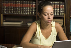 Woman Studying in Library - Horizontal Royalty Free Stock Image
