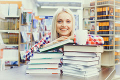 Woman studying in library. Young pretty woman studying in library Royalty Free Stock Photography