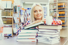 Woman studying in library. Young pretty woman studying in library Stock Photos