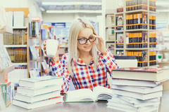 Woman studying in library. Young pretty woman studying in library Royalty Free Stock Photos