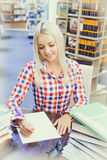 Woman studying in library. Young pretty woman studying in library Stock Photo