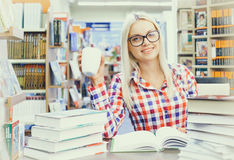 Woman studying in library. Young pretty woman studying in library Stock Images