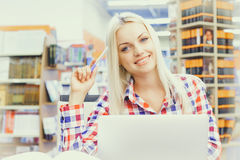 Woman studying in library Royalty Free Stock Images