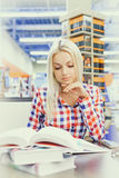 Woman studying in library Stock Photo