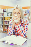 Woman studying in library. Young pretty woman studying in library Royalty Free Stock Images