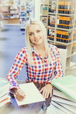 Woman studying in library. Young pretty woman studying in library Stock Image