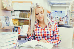 Woman studying in library. Young pretty woman studying in library Royalty Free Stock Photo