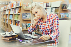 Woman studying in library Stock Images