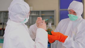 Woman studying the liquid in laboratory Stock Photography