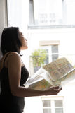 Woman studying map Royalty Free Stock Photography
