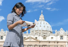 Woman studying a map in Vatican Royalty Free Stock Photography