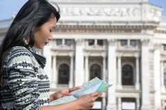 Woman studying map Vienna city Royalty Free Stock Images