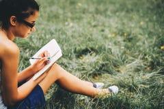 Woman studying outdoor stock photos