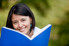 Woman studying outdoors Royalty Free Stock Photo