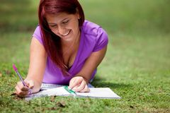 Woman studying outdoors Stock Photos