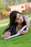 Woman studying outdoors Royalty Free Stock Image