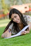 Woman studying outdoors Stock Photo