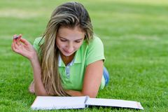 Woman studying outdoors Royalty Free Stock Images