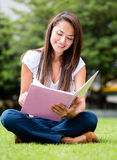 Woman studying outdoors Royalty Free Stock Photography