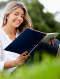 Woman studying at the park Stock Image