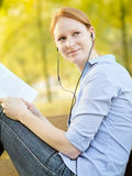Woman Studying in a Park Stock Image