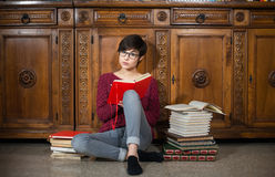 Woman studying seated on the floor Stock Photo