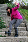 A woman stumbles on a staircase Royalty Free Stock Photo