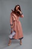 Woman Style. Fashion Model Wearing Fashionable Clothes In Studio. Woman Style And Fashion Clothes. Female Model Wearing Stylish Fashionable Clothing, Light Pink Royalty Free Stock Photo